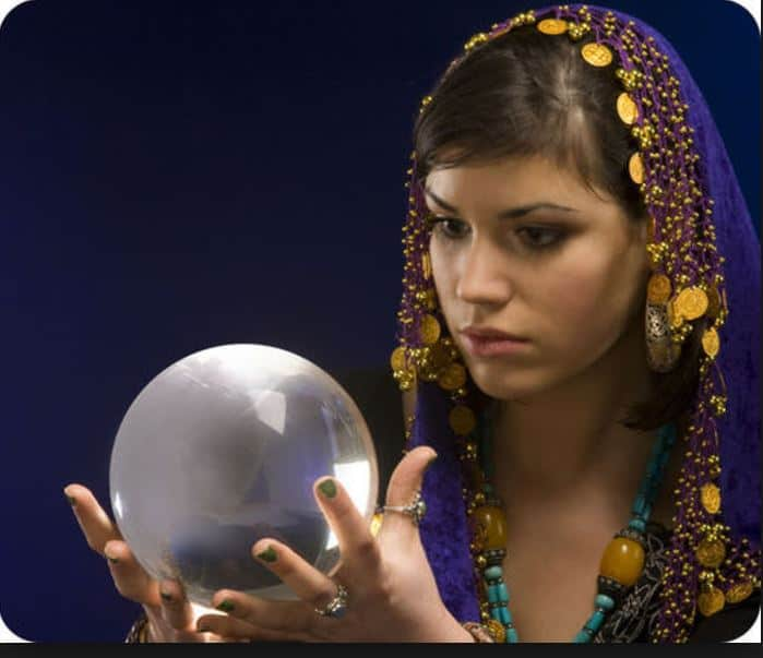 pretty girl predicting with a crystal ball