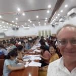 Kevin Baratt teaching Speaking English to a class of 100 IELTS Students
